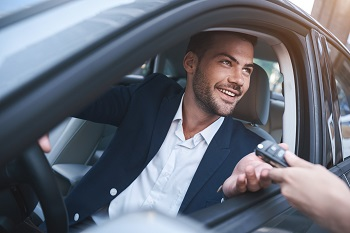 Businessman In Rental Car